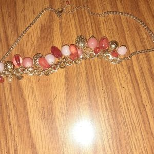 Necklace with pink,rose and gold colored stones